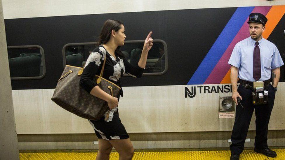 Woman running to catch an East Coast Amtrak Train Service