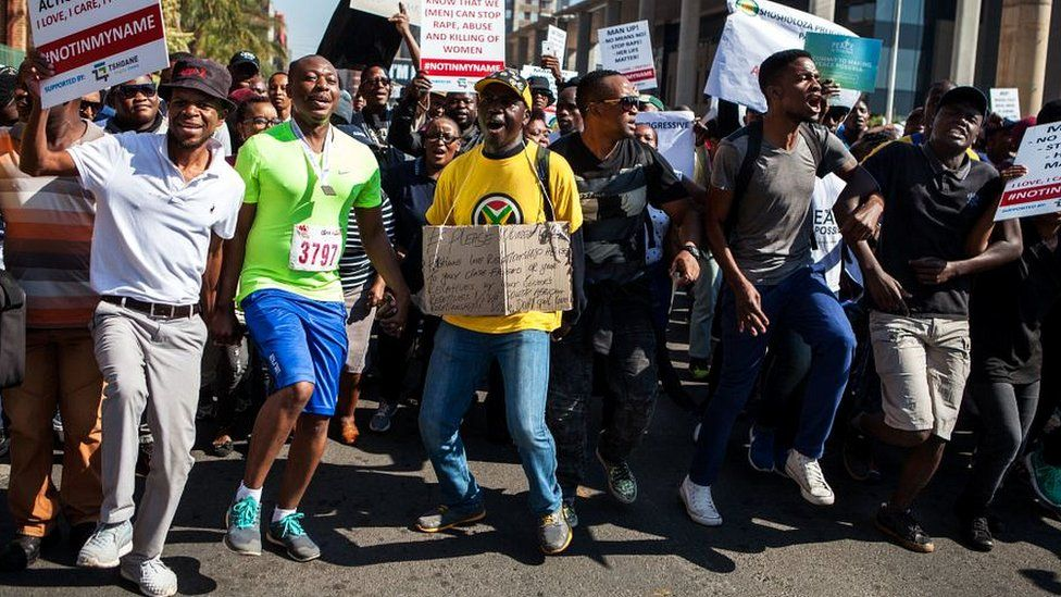 South African men gather during a march organized on May 20, 2017