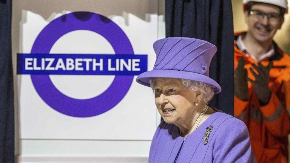 The Queen with an Elizabeth line sign