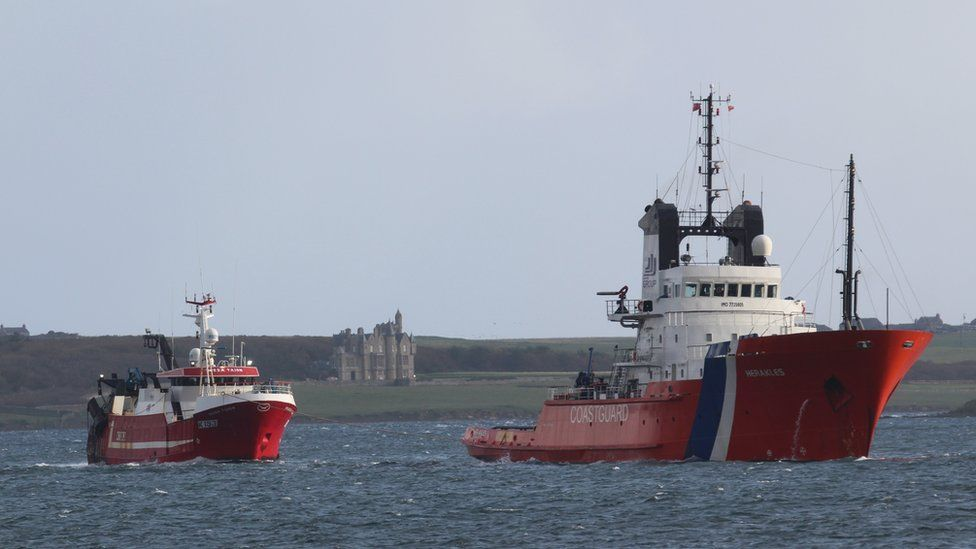 Russa Taign being towed