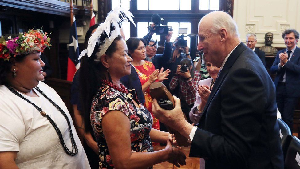 King Harald V of Norway speaks with members of the Easter Island community