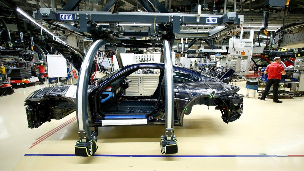 A Porsche 911 being built in a Porsche factory