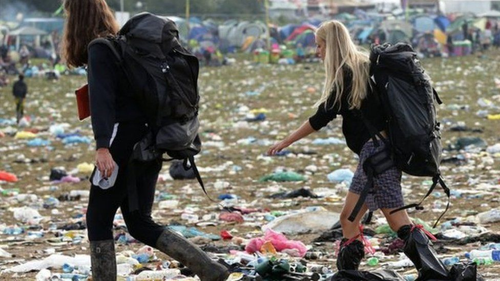 Download: Fans leave muddy festival after heavy rain - BBC News