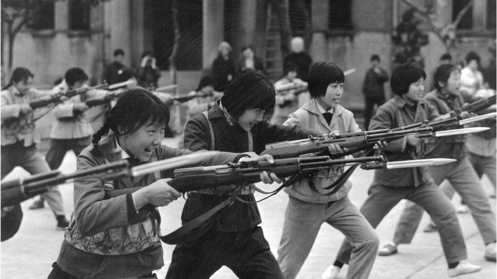 Rows of young girls from the Little Red Guards in Shanghai, practice their bayonet drill on 1 May 1973
