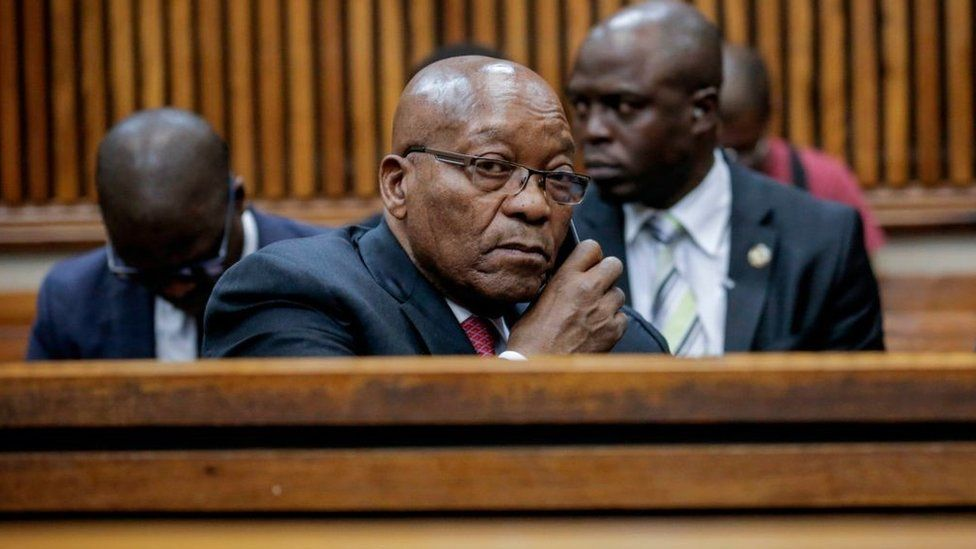 Jacob Zuma speaks on the phone at the Randburg Magistrates Court on October 26, 2018, in Johannesburg