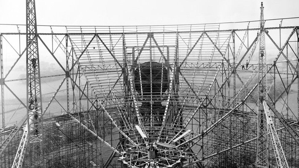 Construction of the steelwork underpinning the reflecting surface of the giant Mark I Telescope (as it was then known, renamed the Lovell Telescope on its 30th anniversary in 1987). Copyright: © Credit: Jodrell Bank Centre for Astrophysics, The University of Manchester.