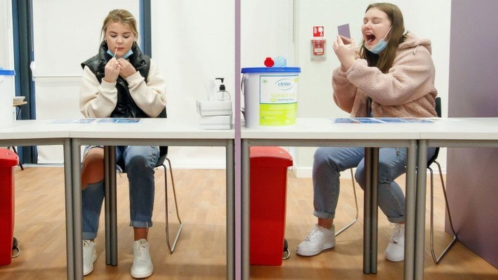 Students Ellie Fisher (left) and Beth Hicks (right) take Coronavirus lateral flow tests at Outwood Academy Adwick in Doncaster, ahead of schools and colleges fully reopening on Monday