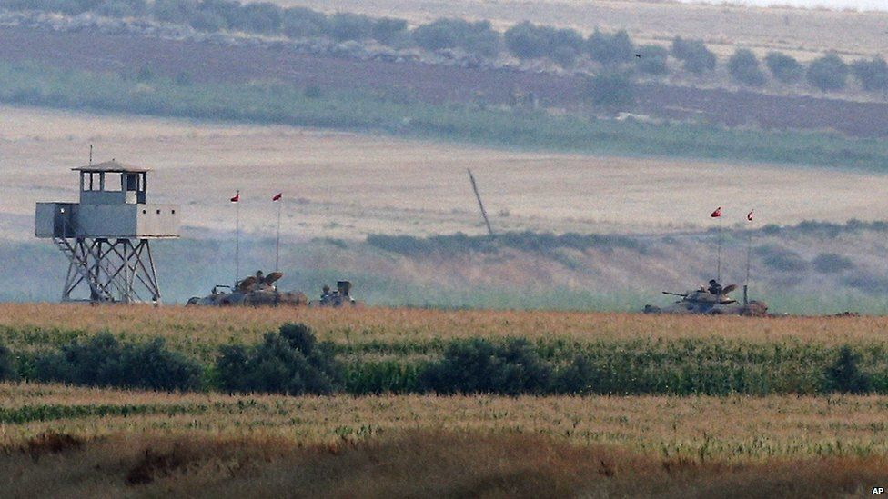 The Turkish army holds positions near the Syrian border