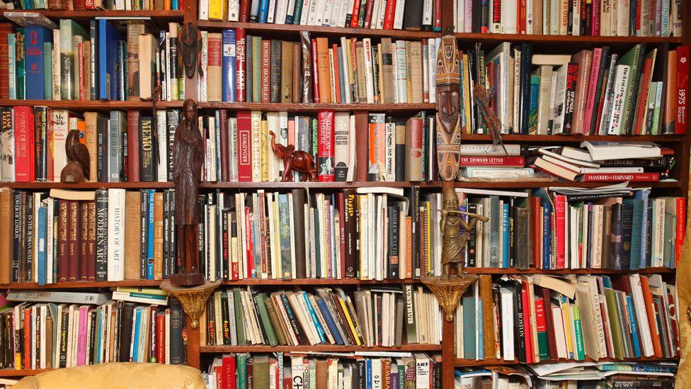 Over-full bookshelf