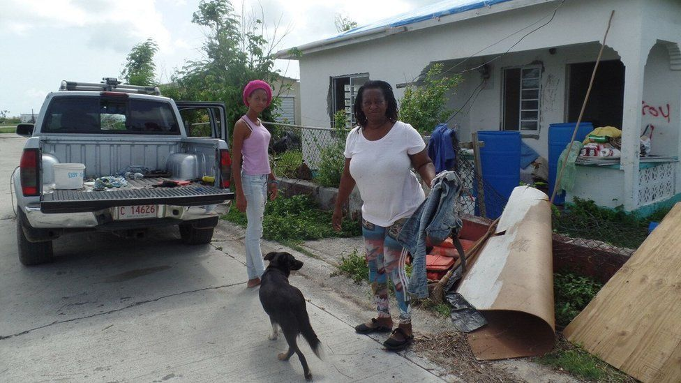 Juliette Warner and daughter Cheniesha, 16, at work clearing debris