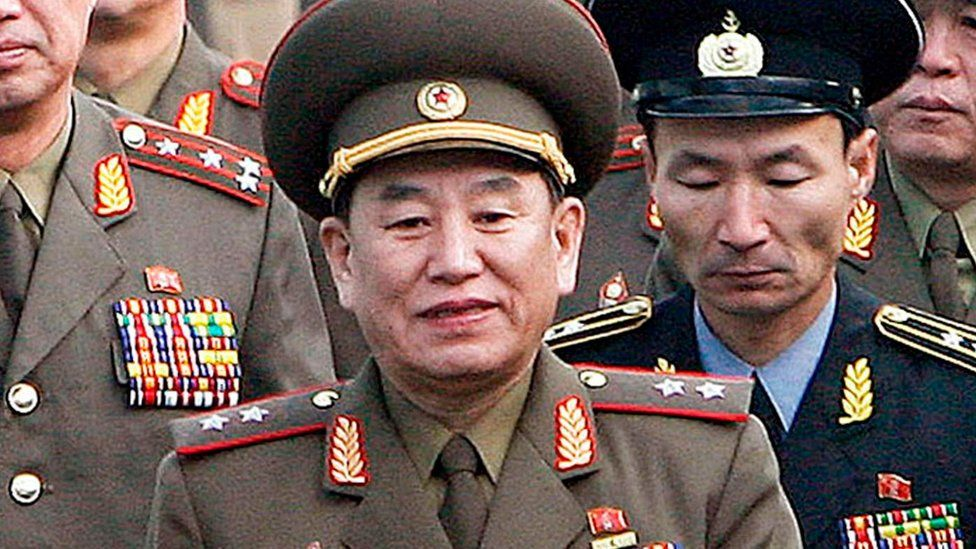 File photo: Kim Yong-Chol and North Korean soldiers marching