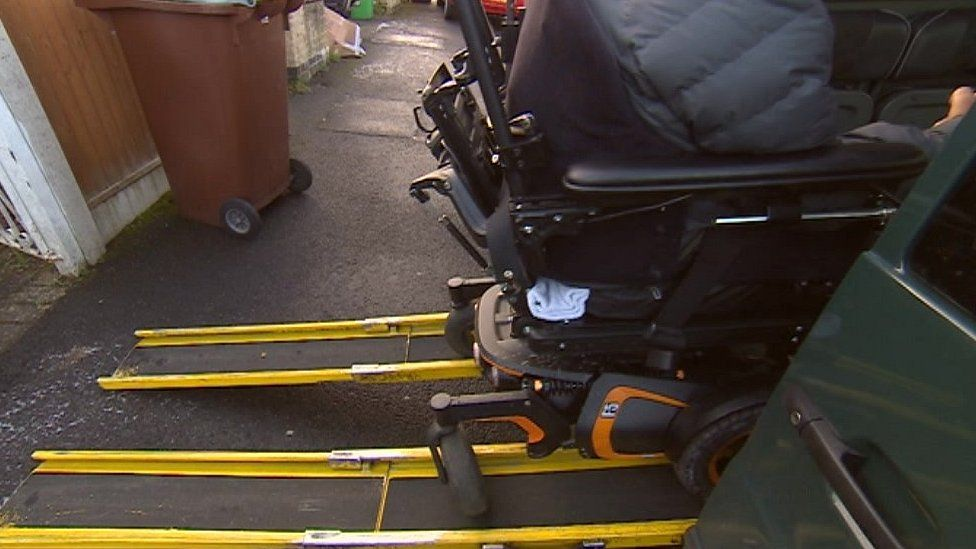 Wheelchair in taxi