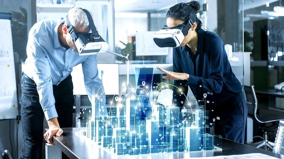 Architects discussing virtual cityscape