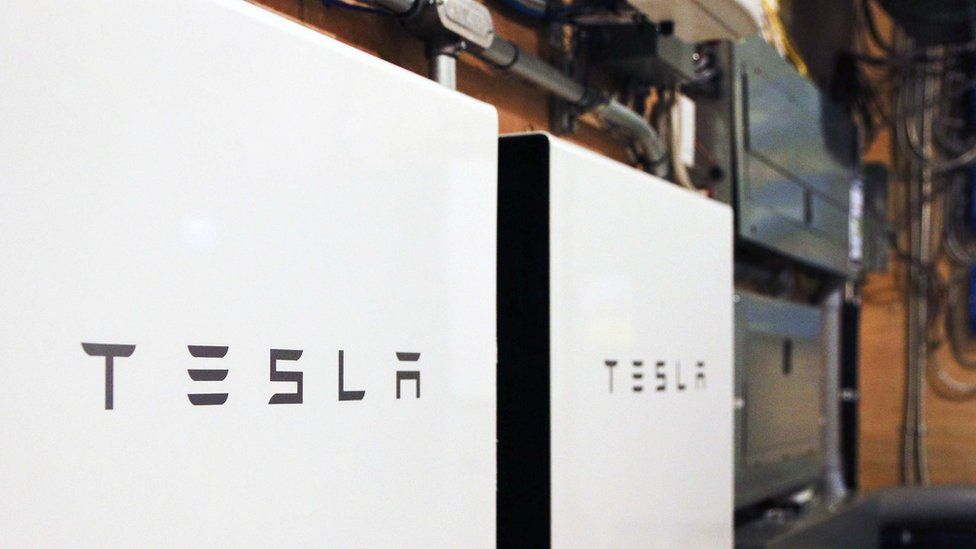 Tesla powerwalls are pictured here in this photo of an apparent garage area