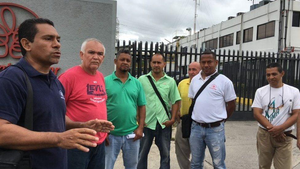 Men outside Alimentos Polar factory