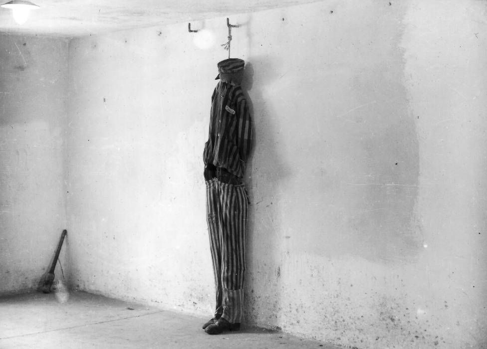 In a photograph taken shortly after the liberation of Buchenwald, a mannequin is used to show how prisoners were hanged in the crematorium cellar