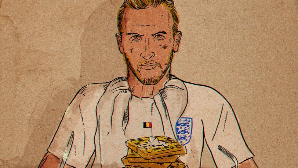 Harry Kane in front of a pile of waffles with a Belgian flag in it