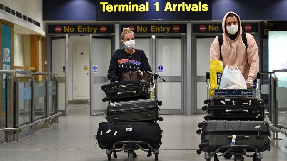 Passengers arrive at Manchester Airport