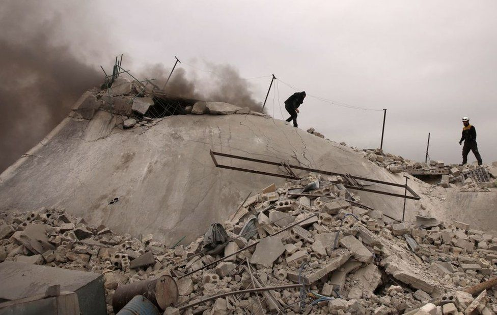 White Helmets approach a collapsed house in countryside west of Aleppo in February 2020