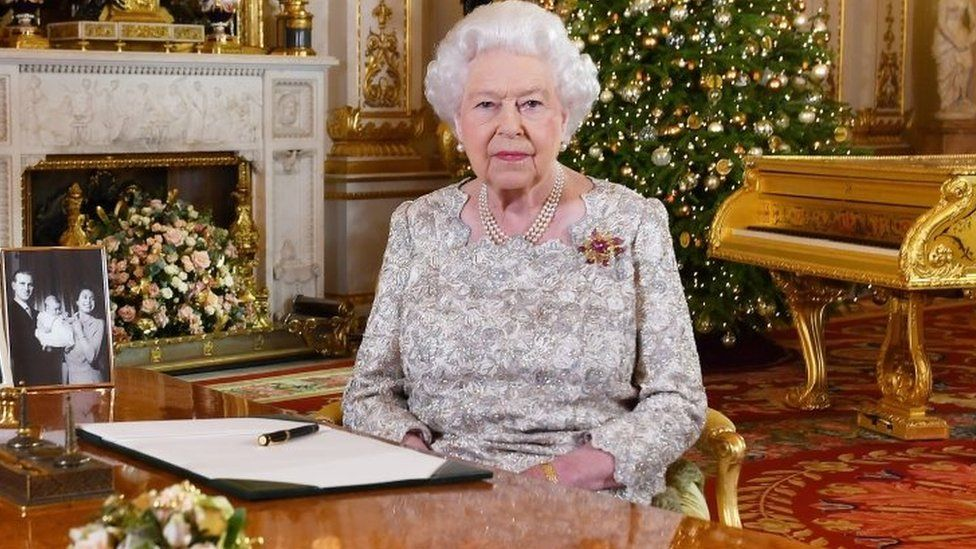 The Queen in the white drawing room of Buckingham Palace
