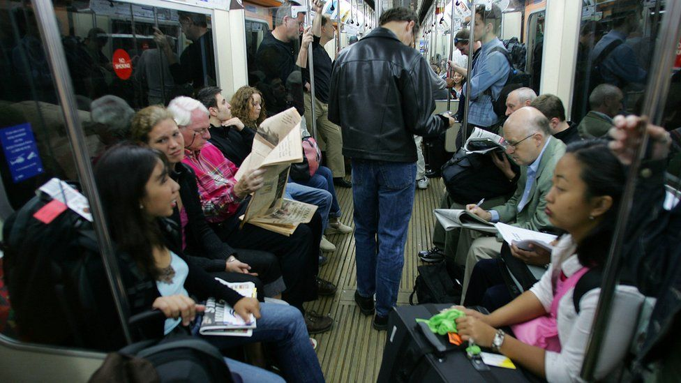 Commuters on a tube train