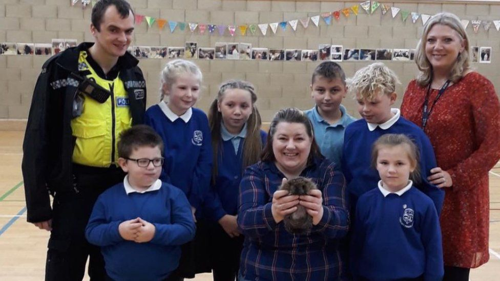 Children from Southwick Primary School with a hedgehog