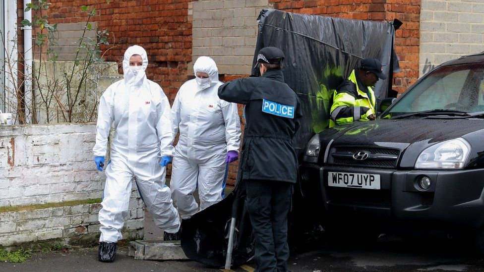 Forensic officers outside the alleyway