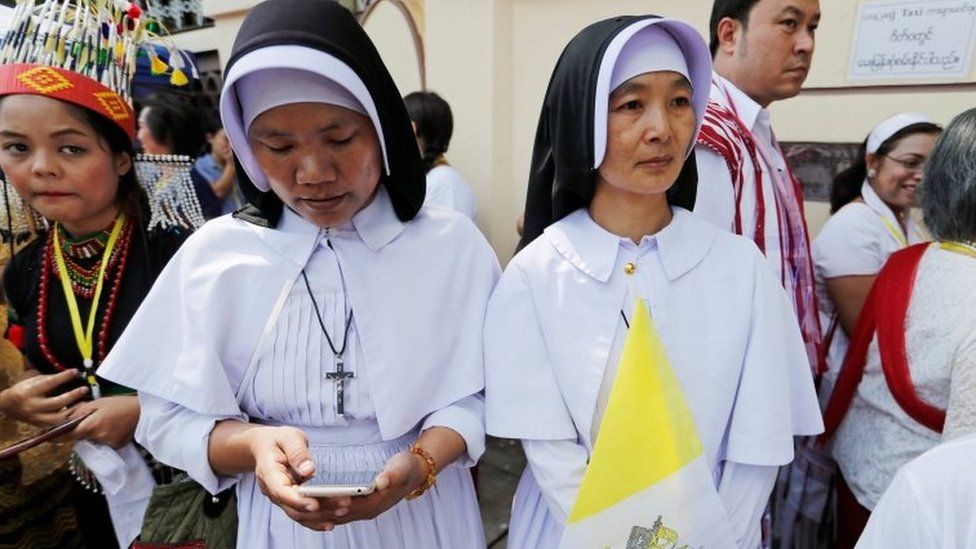 Nuns wait outside the residence of Cardinal Charles Maung Bo, Archbishop of Yangon, where Pope Francis will be staying during his visit in Yangon, Myanmar on 27 November 2017