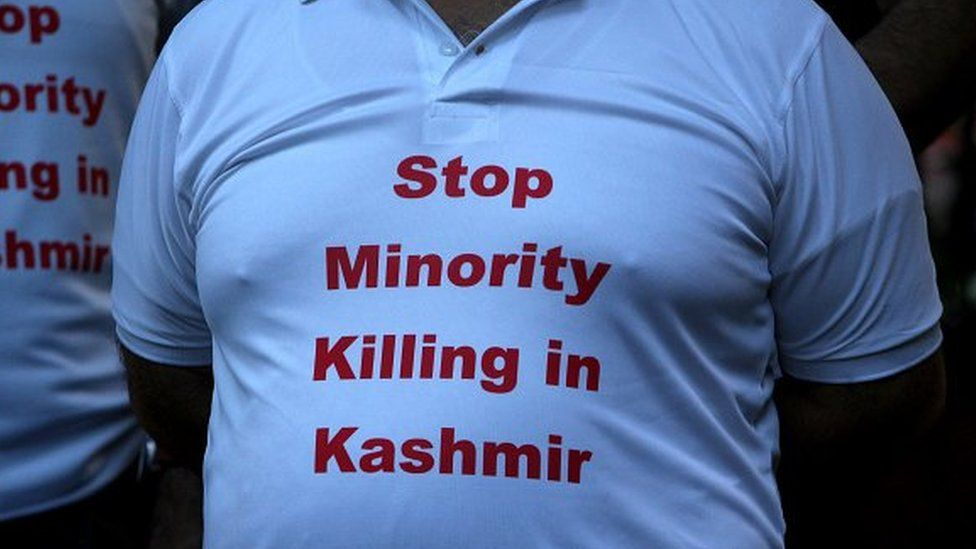 A Kashmiri Hindu, known as Pandit, wears a t-shirt reading 'Stop Minority Killing in Kashmir' during a protest against the recent targeted killings of civilians by militants in Indian-administered Kashmir, in New Delhi