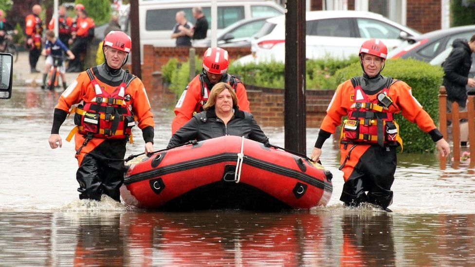 Fire crews rescuing Barking residents using boats