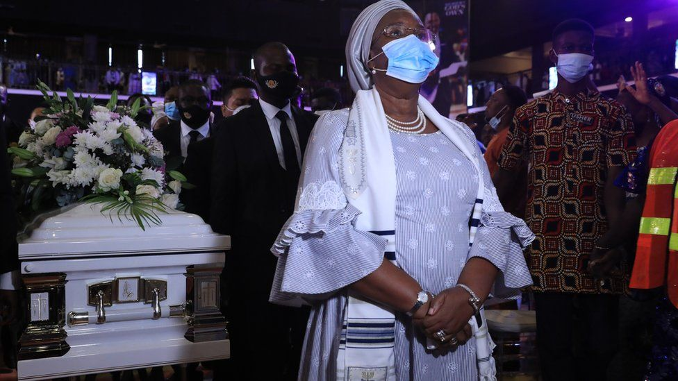 TB Joshua's wife in front of his casket