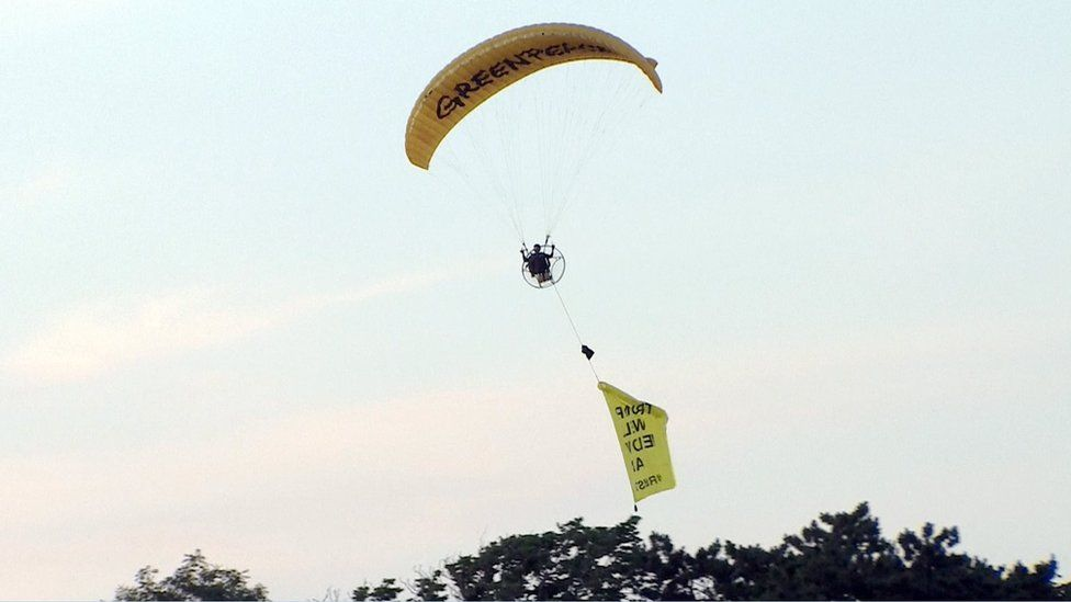paraglider with banner near Turnberry