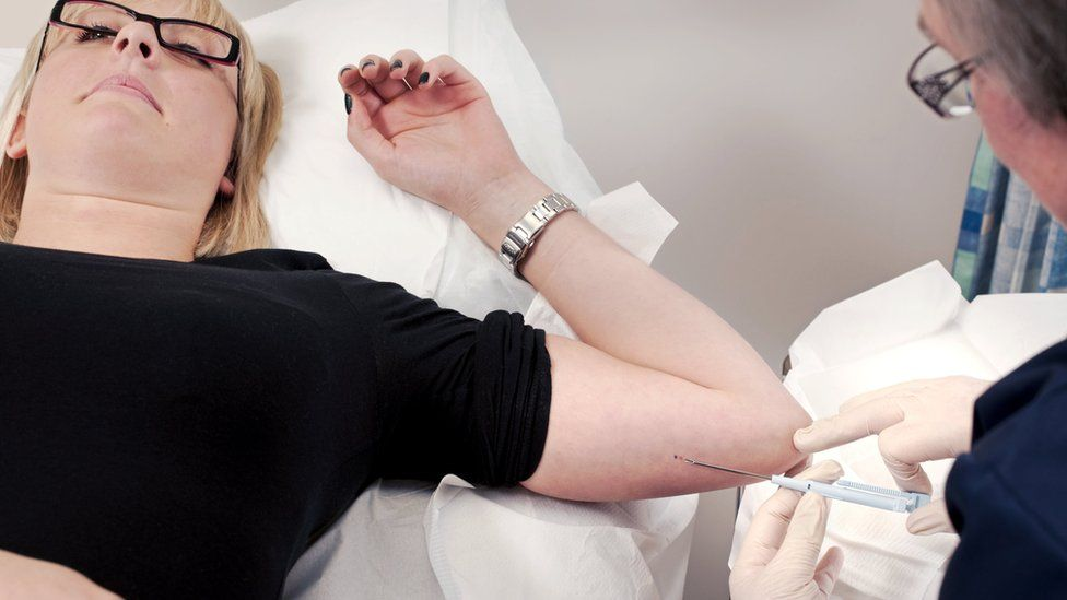 Woman having an implant fitted