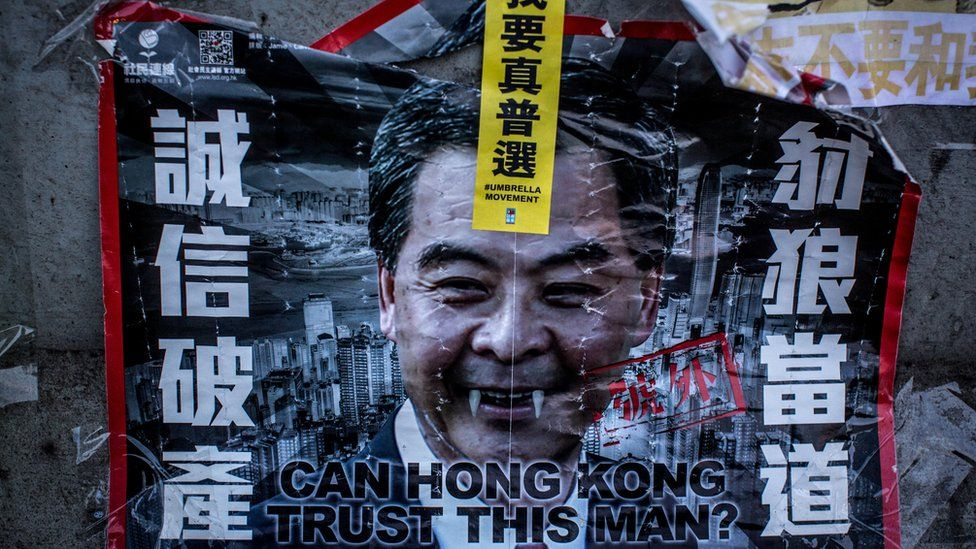 A poster showing Hong Kong's Chief Executive CY Leung is seen on a wall at the Occupy Central protest site in the Admiralty District on October 29, 2014 in Hong Kong