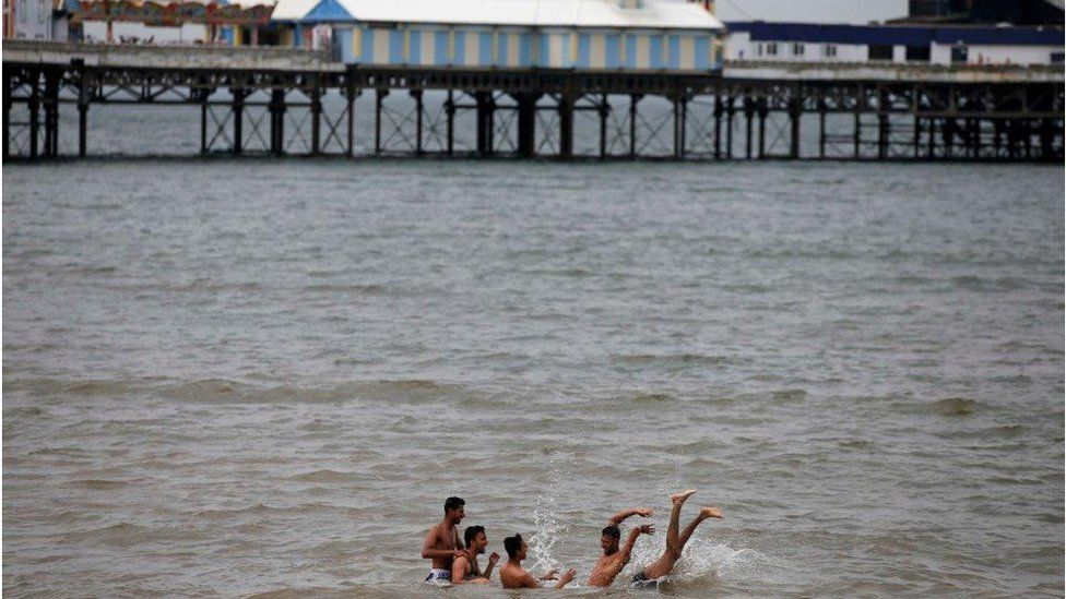 Young men in sea off Blackpool