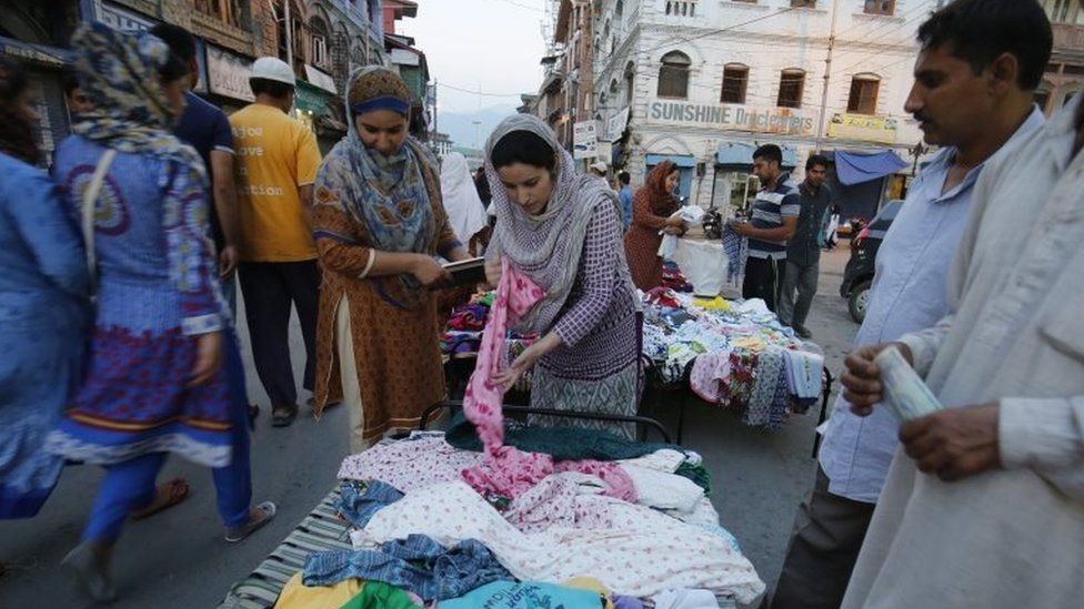 Customers look at the offers at an open market stand in Lal Chowk, the central hub of business activity in Srinagar, the summer capital of Indian Kashmir, 12 September 2016.