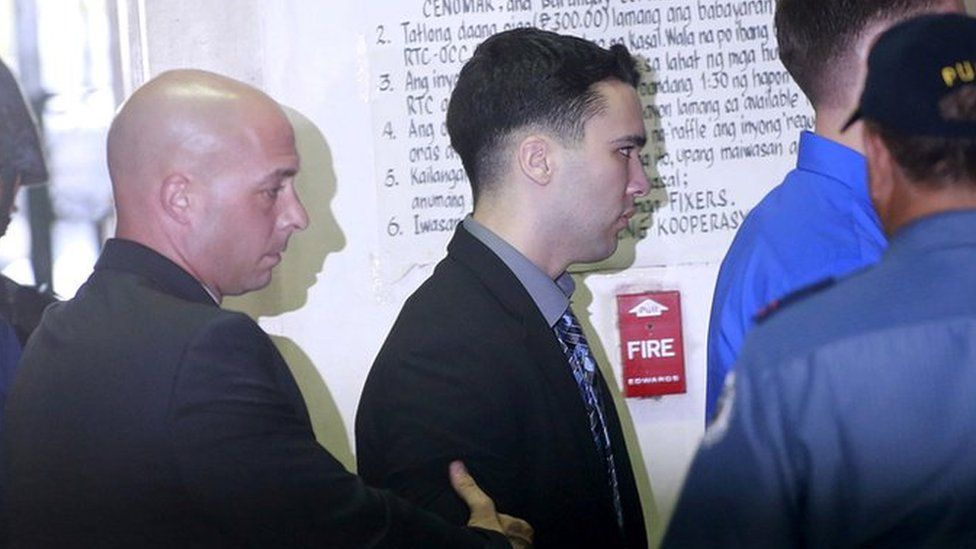 US Marine Lance Corporal Joseph Scott Pemberton (C) is escorted by U.S. security officers into a court in Olongapo city, north of Manila December 1, 2015.