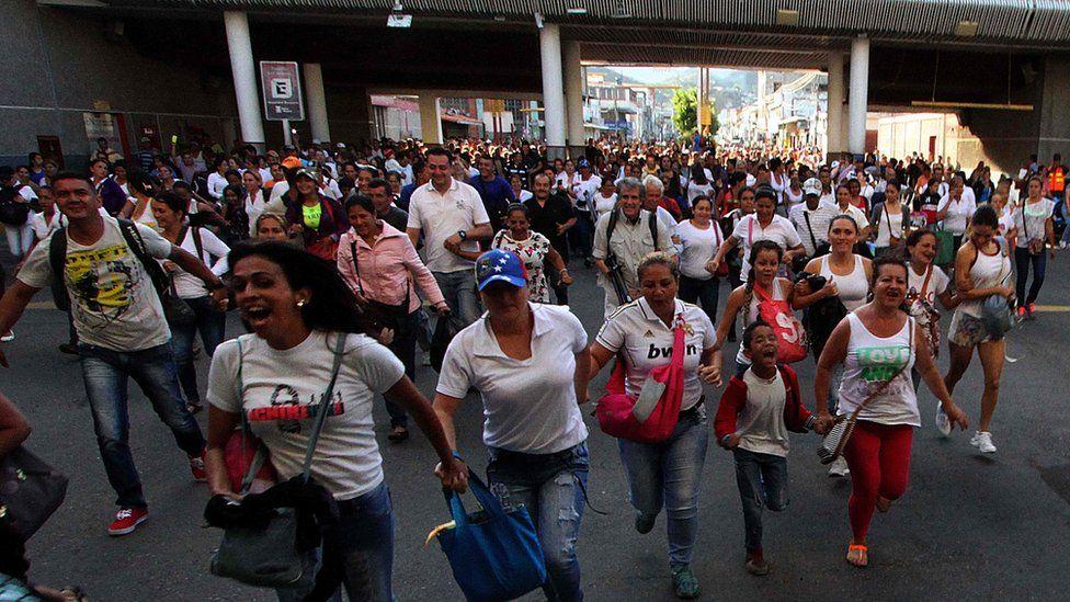Venezuelans cross from San Antonio del Tachira, Venezuela to Cucuta, Colombia on 10 July