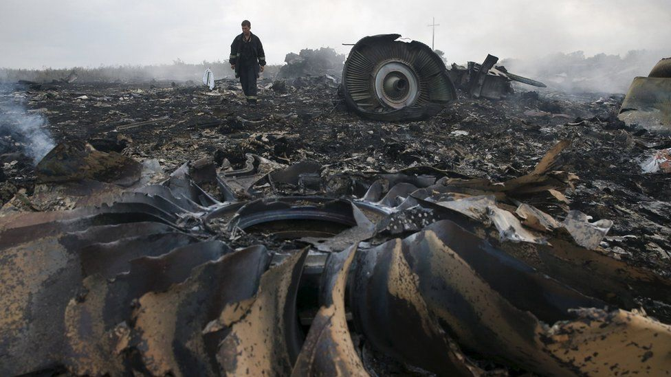 An Emergencies Ministry member walks at a site of a Malaysia Airlines Boeing 777 plane crash near the settlement of Grabovo in the Donetsk region