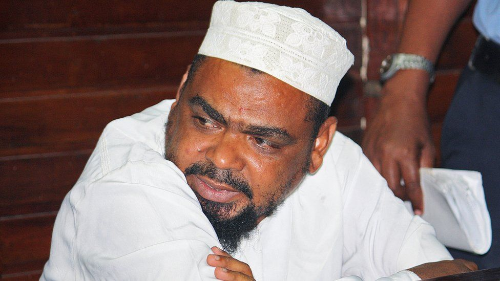 Muslim cleric Aboud Rogo Mohammed sits in the Mombasa Law courts on January 30, 2012 after being charged with possession of dangerous weapons, an AK 47 rifle, 133 rounds of ammunitions, two hand grenades, and two pistols.