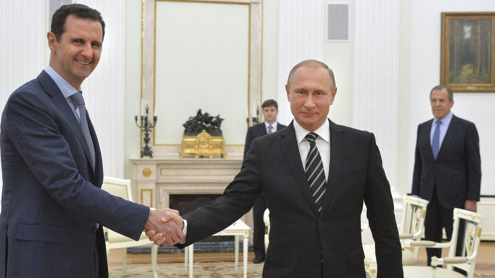 Syrian President Bashar al-Assad shakes hands with Russian President Vladimir Putin at the Kremlin in Moscow, Russia (20 October 2015)