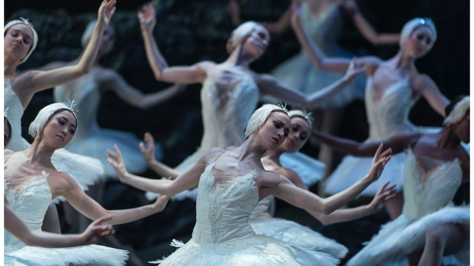 The ballet corps in ENO's Swan Lake dance in white