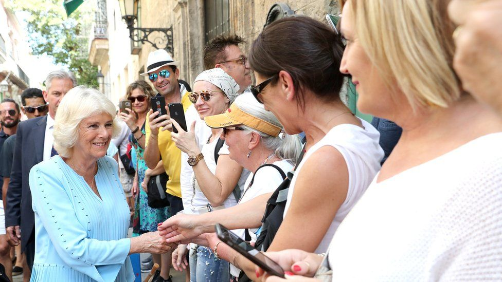 Duchess of Cornwall greets well-wishers during a guided tour of Old Havana