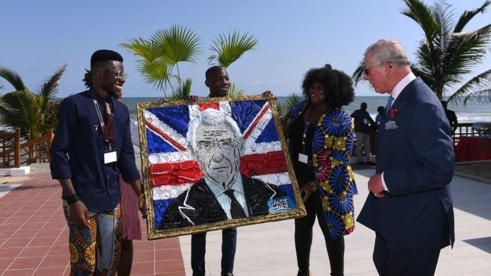 The Prince of Wales is presented with a portrait of himself made from recycled plastics as he attends a plastics event, at Sandbox, Accra, Ghana, on day six of his trip to west Africa with the Duchess of Cornwall