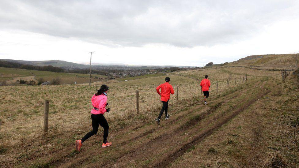 Joggers run in Buxton as the spread of the coronavirus disease (COVID-19) continues, Buxton, Britain