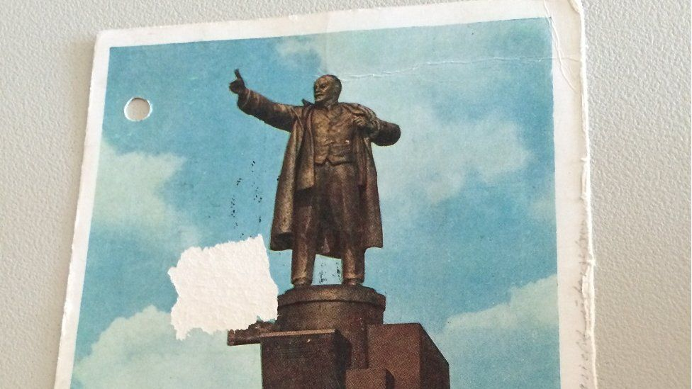 A postcard showing a statue of Lenin