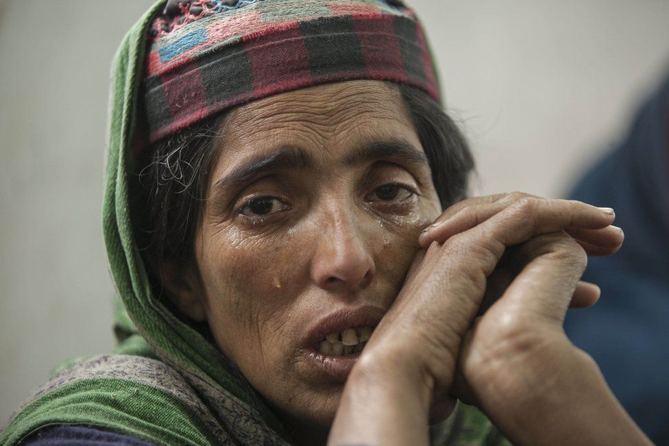 A woman at the relief camp is seen crying.