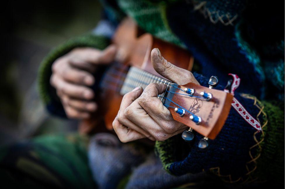 Stewart playing his ukulele