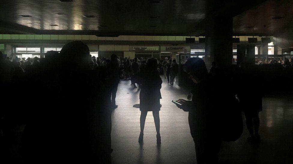 Passengers are seen during a blackout at Simon Bolivar international airport in Caracas, Venezuela March 25, 20