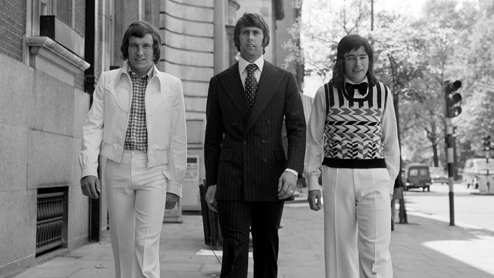 Bob McNab of Arsenal, Geoff Hurst of West Ham and Peter Marinello of Arsenal give a preview of styles they will model at a charity showing of Playboy international menswear collection to be attended by Princess Margaret in Chelsea